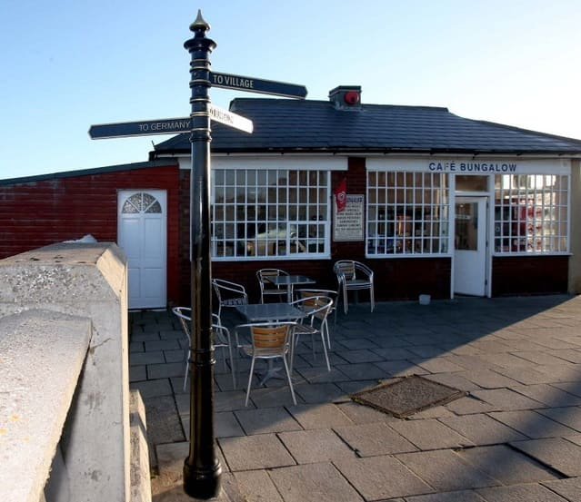 Roker Bungalow Cafe signpost to Germany