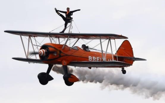 Sunderland International Airshow acrobatics in the sky standing on aeroplane