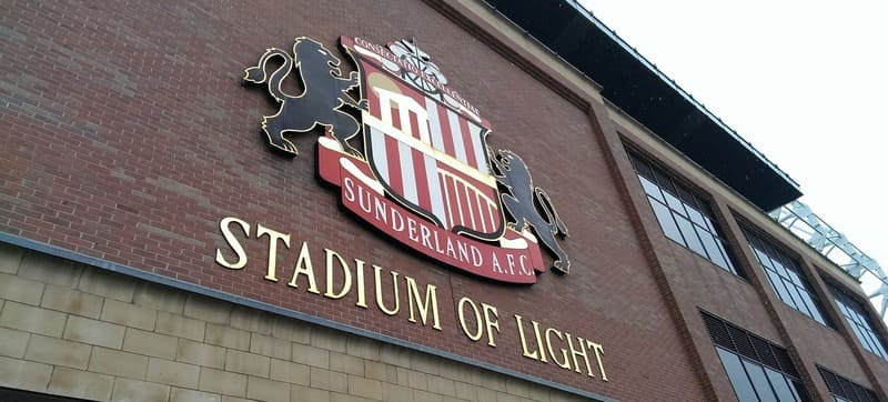 Stadium of Light with club badge on the wall